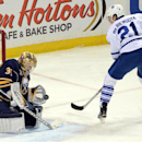 Buffalo Sabres goaltender Michal Neuvirth (34), of the Czech Republic, makes a breakaway save on Toronto Maple Leafs left winger James van Riemsdyk (21) during the first period of an NHL hockey game Saturday, Nov. 15, 2014, in Buffalo, N.Y The Associat