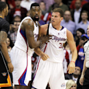 Los Angeles Clippers center DeAndre Jordan, center, pulls Clippers forward Blake Griffin (32) away from the a challenge from Phoenix Suns forward Marcus Morris (15) during the second half of an NBA basketball game Monday, March 10, 2014, in Los Angeles. T