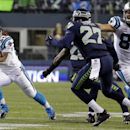 Carolina Panthers running back DeAngelo Williams (34) runs against the Seattle Seahawks during the first half of an NFL divisional playoff football game in Seattle, Saturday, Jan. 10, 2015 The Associated Press