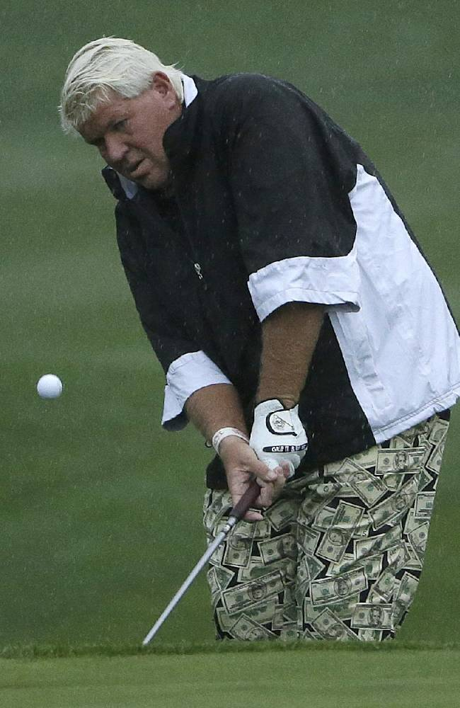 John Daly chips onto the first green Thursday, Feb. 6, 2014, during the first round of the AT&T Pebble Beach Pro-Am golf tournament Thursday, Feb. 6, 2014, on the Spyglass Hill Golf Course in Pebble Beach, Calif