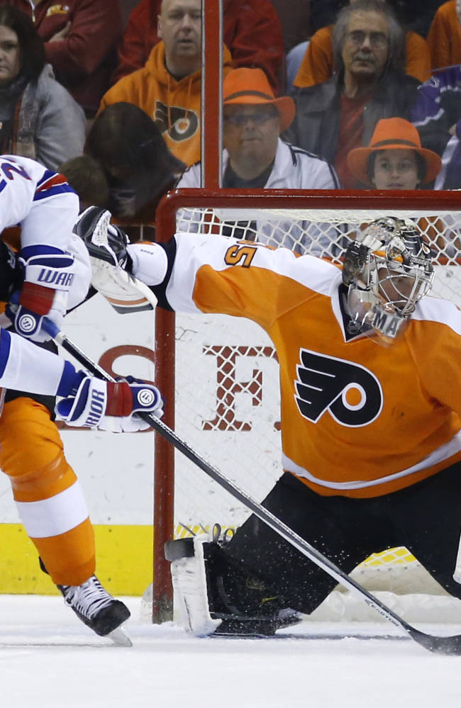 Philadelphia Flyers' Steve Mason, right, blocks a shot by New York Rangers' Ryan Callahan during the second period of an NHL hockey game, Saturday, March 1, 2014, in Philadelphia