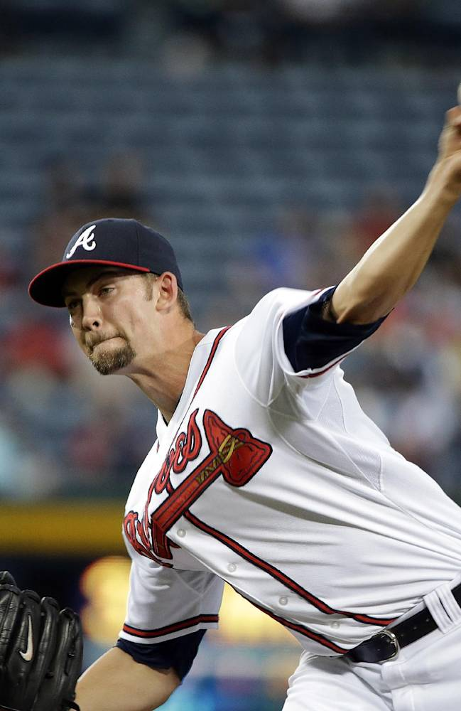 Atlanta Braves starting pitcher Mike Minor throws in the first inning of a baseball game against the Milwaukee Brewers, Monday, Sept. 23, 2013 in Atlanta
