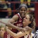 Oklahoma's Aaryn Ellenberg, left, and Morgan Hook celebrate their win over UCLA in a second-round game in the women's NCAA college basketball tournament Monday, March 25, 2013, in Columbus, Ohio. Oklahoma beat UCLA 85-72. (AP Photo/Jay LaPrete)