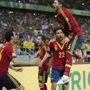 Spain's Jesus Navas (22) celebrates with his teammates after scoring the winning penalty goal against Italy's goalkeeper Gianluigi Buffon during the penalty shootout of their Confederations Cup semi-final soccer match at the Estadio Castelao in Fortaleza June 27, 2013. REUTERS/Jorge Silva