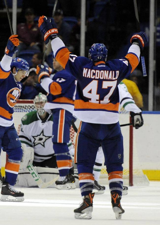 New York Islanders' John Tavares, second from left, celebrates his goal against the Dallas Stars with teammates in the third period of an NHL hockey game on Monday, Jan. 6, 2014, in Uniondale, N.Y. Tavares scored three goals during the Islanders 7-3 win
