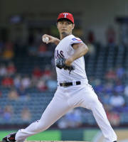 Texas Rangers starting pitcher Yu Darvish, of Japan, throws during the first inning of a baseball game against the Arizona Diamondbacks Thursday, Aug. 1, 2013, in Arlington, Texas. (AP Photo/LM Otero)