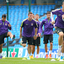 Manchester City's Edin Dzeko, right, takes part with other team members in a training session at the Etihad Stadium, Manchester, England, Monday Sept. 29, 2014. Manchester City face Roma in a Group E Champions League match on Tuesday