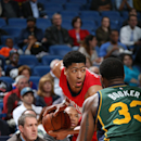 NEW ORLEANS, LA - DECEMBER 16: Anthony Davis #23 of the New Orleans Pelicans handles the ball against Trevor Booker #33 of the Utah Jazz on December 16, 2014 at the Smoothie King Center in New Orleans, Louisiana. (Photo by Layne Murdoch Jr./NBAE via Getty Images)