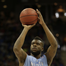 North Carolina guard/forward Reggie Bullock (35) shoots during the first half of a third-round game against Kansas in the NCAA college basketball tournament Sunday, March 24, 2013, in Kansas City, Mo. Kansas won the game 70-58. (AP Photo/Charlie Riedel)