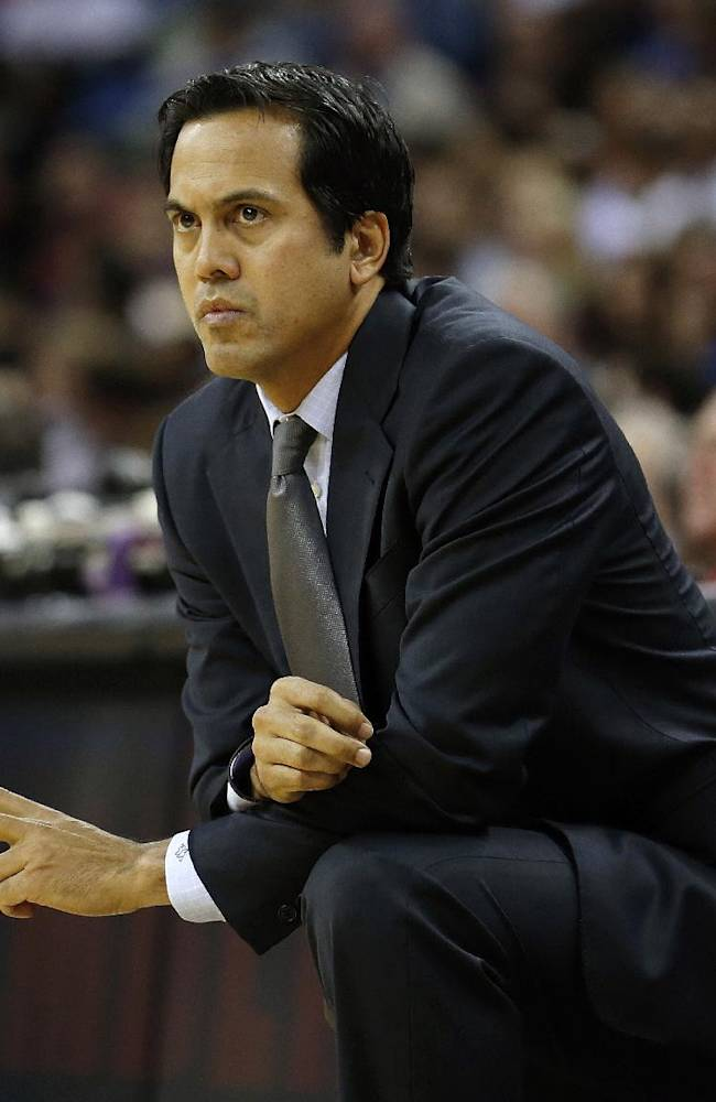 Miami Heat head coach Erik Spoelstra watches the action against the New Orleans Pelicans in the first half of a preseason NBA basketball game in New Orleans, Wednesday, Oct. 23, 2013