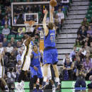 Dallas Mavericks' Dirk Nowitzki (41) shoots as Utah Jazz's Jeremy Evans defends in the second half during an NBA basketball game Wednesday, March 12, 2014, in Salt Lake City. The Mavericks won 108-101. (AP Photo/Rick Bowmer)