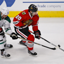 Chicago Blackhawks left wing Brandon Saad (20) controls the puck in front of Dallas Stars left wing Jamie Benn (14) during the second period of an NHL hockey game in Chicago, Sunday, Jan. 18, 2015 The Associated Press