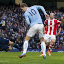 Manchester City's Edin Dzeko, centre, misses from close range as Stoke's goalkeeper Asmir Begovic, left, guards his net during their English Premier League soccer match at the Etihad Stadium, Manchester, England, Saturday Feb. 22, 2014