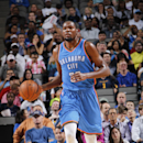 DALLAS, TX - OCTOBER 10: Kevin Durant #35 of the Oklahoma City Thunder handles the ball against the Dallas Mavericks on October 10, 2014 at the American Airlines Center in Dallas, Texas. (Photo by Glenn James/NBAE via Getty Images)