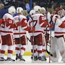 Detroit Red Wings players celebrate with goalie Petr Mrazek, of the Czech Republic, right, after the Red Wings defeated the Tampa Bay Lightning 4-0 during Game 5 of a first-round NHL Stanley Cup hockey playoff series Saturday, April 25, 2015, in Tampa, Fla. (AP Photo/Chris O'Meara)