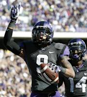 TCU wide receiver Josh Doctson (9) celebrates after his touchdown catch in front of TCU's David Porter against West Virginia during the first half of an NCAA football game, Saturday, Nov. 2, 2013, in Fort Worth, Texas. (AP Photo/Jim Cowsert)