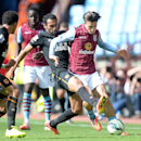 Aston Villa's Jack Grealish, right, battles for the ball with Hull City's Ahmed Elmohamady, second right, during their English Premier League soccer match at Villa Park, Birmingham, England, Sunday, Aug. 31, 2014