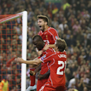 Liverpool's Mario Balotelli, center, celebrates with teammates after scoring against Ludogorets during the Champions League Group B soccer match between Liverpool and Ludogorets at Anfield Stadium in Liverpool, England, Tuesday, Oct. 16, 2014
