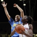 Stanford 's Chiney Ogwumike, right, shoots next to UCLA 's Alyssia Brewer during the first half of an NCAA college basketball game in Stanford, Calif., Friday, Jan. 18, 2013. (AP Photo/Marcio Jose Sanchez)