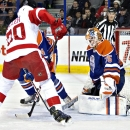 Detroit Red Wings Drew Miller (20) is stopped by Edmonton Oilers goalie Viktor Fasth (35) during first period NHL hockey action in Edmonton, Alberta, on Tuesday Jan. 6, 2015 The Associated Press