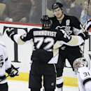 Pittsburgh Penguins' Chris Kunitz (14) celebrates his goal with teammate Patric Hornqvist (72) behind Los Angeles Kings goalie Martin Jones (31) and Mike Richards (10) in the third period of an NHL hockey game in Pittsburgh, Thursday, Oct. 30, 2014. The P