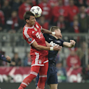 Bayern's Mario Mandzukic, left, rises above Manchester United's Darren Fletcher to win a header during the Champions League quarterfinal second leg soccer match between Bayern Munich and Manchester United in the Allianz Arena in Munich, Germany, Wednesday