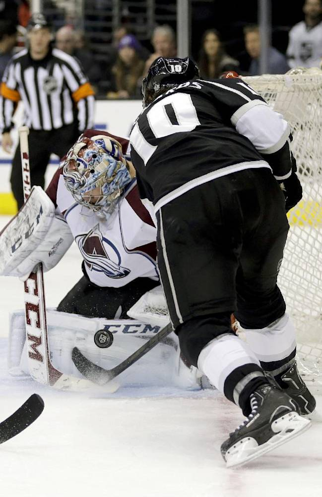 Colorado Avalanche goalie Semyon Varlamov, left, blocks a shot by Los Angeles Kings center Mike Richards during the second period of an NHL hockey game, Saturday, Dec. 21, 2013, in Los Angeles