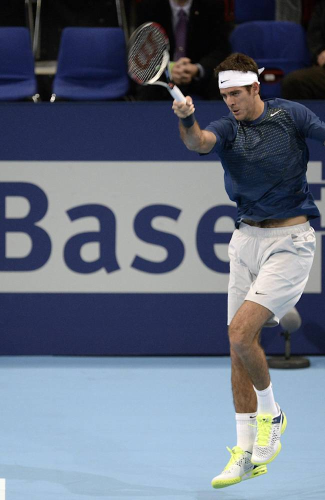 Argentina's Juan Martin Del Potro returns a ball to Switzerland's Henri Laaksonen during their first round match at the Swiss Indoors tennis tournament at the St. Jakobshalle in Basel, Switzerland, on Wednesday, Oct. 23, 2013