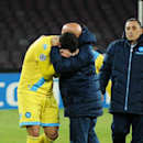 Napoli's Gonzalo Higuain is comforted by a team staffer as he walks off the pitch at the end of a Champions League, group F, soccer match between Napoli and Arsenal, at the Naples San Paolo stadium, Italy, Wednesday, Dec. 11, 2013. Ten-man Arsenal advance