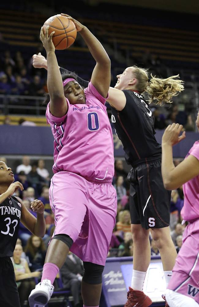Washington's Chantel Osahor (0) grabs a rebound in front of Stanford's Mikaela Ruef in the first half of an NCAA women's basketball game, Sunday, Feb. 9, 2014, in Seattle. Washington upset Stanford 87-82