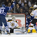 Toronto Maple Leafs left winger James van Riemsdyk celebrates teammate Tyler Bozak's (42) goal on Boston Bruins goaltender Chad Johnson, second from left, as right winger Jordan Caron stands near during the first period of an NHL hockey game in Toronto on
