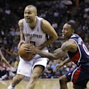 San Antonio Spurs' Tony Parker, left, of France, is defended by Atlanta Hawks' Jeff Teague, right, as he drives to score during the first half of an NBA basketball game, Monday, Dec. 2, 2013, in San Antonio The Associated Press