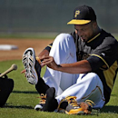 Pittsburgh Pirates pitcher Francisco Liriano takes off his spikes after a morning workout at baseball spring training in Bradenton, Fla., Sunday, Feb. 16, 2014 The Associated Press