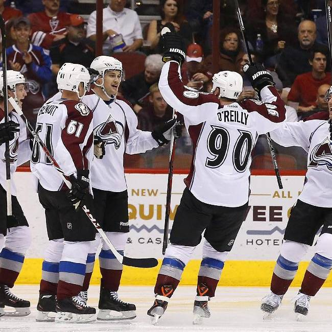 Colorado Avalanche's John Mitchell, center, celebrates his goal against the Phoenix Coyotes with teammates Nathan MacKinnon (29), Andre Benoit (61), P.A. Parenteau, right, during the second period of an NHL hockey game Thursday, Nov. 21, 2013, in Glendale, Ariz