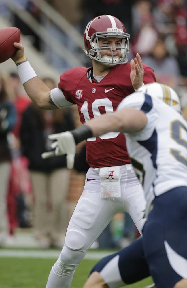 Alabama quarterback AJ McCarron (10) looks for a receiver as Chattanooga defensive lineman Davis Tull (90) rushes in during the first half of an NCAA college football game in Tuscaloosa, Ala., Saturday, Nov. 23, 2013