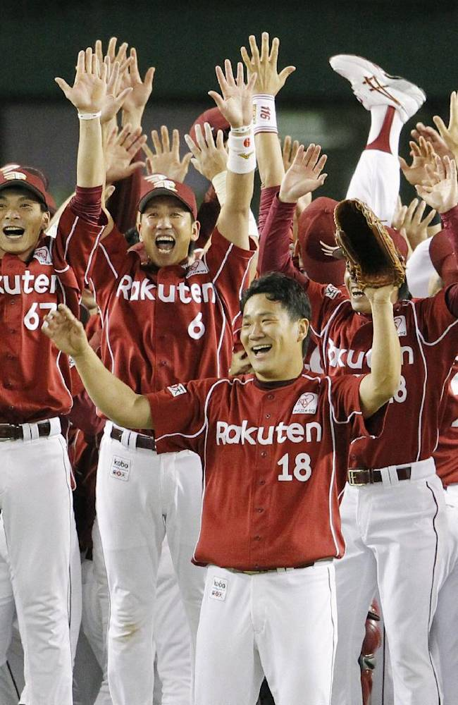 In this Thursday, Sept. 26, 2013 photo, Rakuten Eagles pitcher Masahiro Tanaka, cener, and his teammates celebrate after defeating the Seibu Lions to clinch the team's first Pacific League franchise in Tokorozawa, Saitama Prefecture, northwest of Tokyo. Tanaka will be aiming to extend one of the most successful runs in the history of professional baseball when he takes the mound for the Rakuten Eagles in Game 1 of the Japan Series on Saturday, Oct. 26