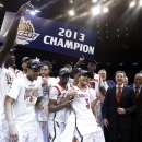 FILE - In this March 16, 2013, file photo, Louisville's Peyton Siva (3) celebrates with teammates after an NCAA college basketball championship game against Syracuse at the Big East Conference tournament in New York. (AP Photo/Frank Franklin II, File)