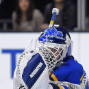 St. Louis Blues goalie Martin Brodeur makes a glove save during the second period of an NHL hockey game against the Los Angeles Kings, Thursday, Dec. 18, 2014, in Los Angeles. (AP Photo/Mark J. Terrill)