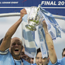 Manchester City captain Vincent Kompany, left, and Samir Nasri celebrate after their team's 3-1 win against Sunderland in the League Cup Final at Wembley Stadium, London, England, Sunday March 2, 2014