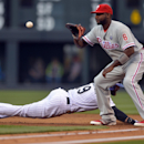 Colorado Rockies' Charlie Blackmon (19) beats the throw back to Philadelphia Phillies first baseman Ryan Howard (6) during the first inning on Friday, April 18, 2014, in Denver The Associated Press