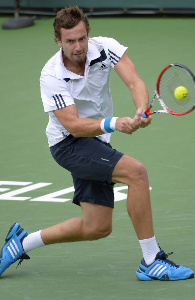 Ernests Gulbis, of Latvia, hits to Grigor Dimitrov, of Bulgaria, during their third round match at the BNP Paribas Open tennis tournament, Tuesday, March 11, 2014, in Indian Wells, Calif