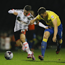 Fulham's Patrick Roberts, left, vies for the ball with Derby's Craig Forsyth during the English League Cup soccer match between Fulham and Derby County at Craven Cottage stadium in London, Tuesday, Oct. 28, 2014