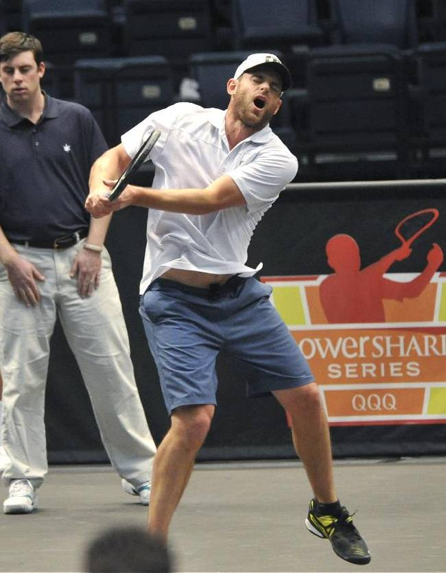 Andy Roddick reacts after a serve from Mark Philippoussis struck him in the crotch during a semifinal of the PowerShares Series Champions Shootout tennis tournament in Birmingham, Ala., Thursday, Feb. 13, 2014. Roddick fell to the ground for a while to regain his composure