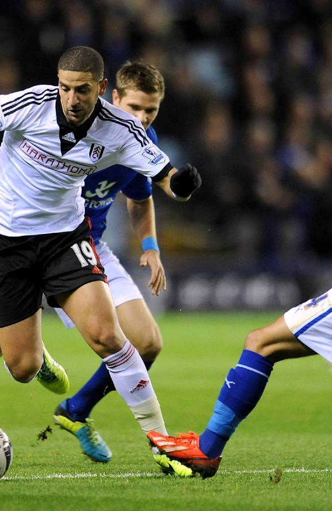 Fulham's Adel Taarabt and Leicester City's Anthony Knockaert, right, in action during their English League Cup, Fourth Round match at the King Power Stadium, Leicester, England, Tuesday Oct. 29, 2013