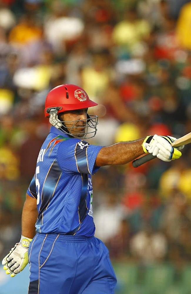 Afghanistan's Samiullah Shenwari acknowledges the crowd after scoring fifty runs during the Asia Cup one-day international cricket tournament against Bangladesh in Fatullah, near Dhaka, Bangladesh, Saturday, March. 1, 2014