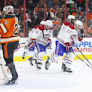 Montreal Canadiens' Alex Galchenyuk, right, skates back with his teammates after tying an NHL hockey game up against Philadelphia Flyers' Ray Emery, left, during the third period Saturday, Oct. 11, 2014, in Philadelphia. The Canadians won 4-3 in a shootou