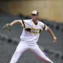 Michigan starting pitcher pitcher Evan Hill (21) delivers against Illinois during the first inning of a fourth-round NCAA Big Ten tournament college baseball game Saturday, May 23, 2015, in Minneapolis. (AP Photo/Hannah Foslien)