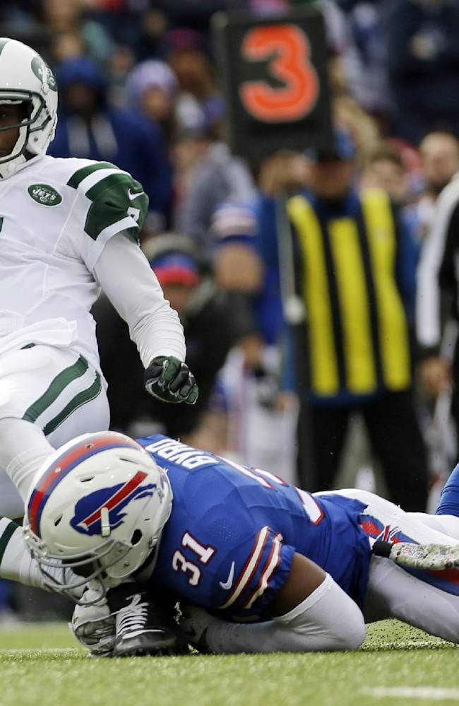 New York Jets quarterback Geno Smith (7) is sacked by Buffalo Bills free safety Jairus Byrd (31) during the first half of an NFL football game on Sunday, Nov. 17, 2013, in Orchard Park, N.Y