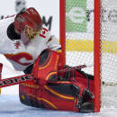 Calgary Flames goalie Jonas Hiller, of Switzerland, is scored on by Los Angeles Kings defenseman Jamie McBain during the second period of an NHL hockey game, Monday, Dec. 22, 2014, in Los Angeles. (AP Photo/Mark J. Terrill)