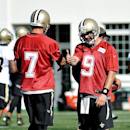 New Orleans Saints quarterback Drew Brees (9) and quarterback Luke McCown (7) discuss a pass route during NFL football training camp in White White Sulphur Springs, W.Va., Saturday, July 26, 2014 The Associated Press